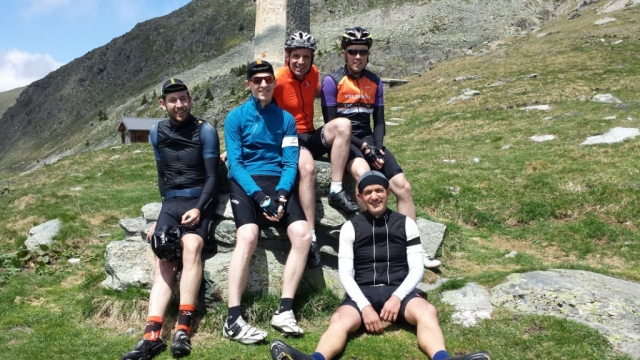 Group of cyclists at the top of Croix de Fer, French Alps