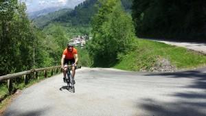 Cyclist climbing Pas de la Confession in French Alps