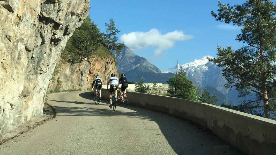 Cyclists with Mountain views on Balcon Road to Alpe d'Huez, French Alps