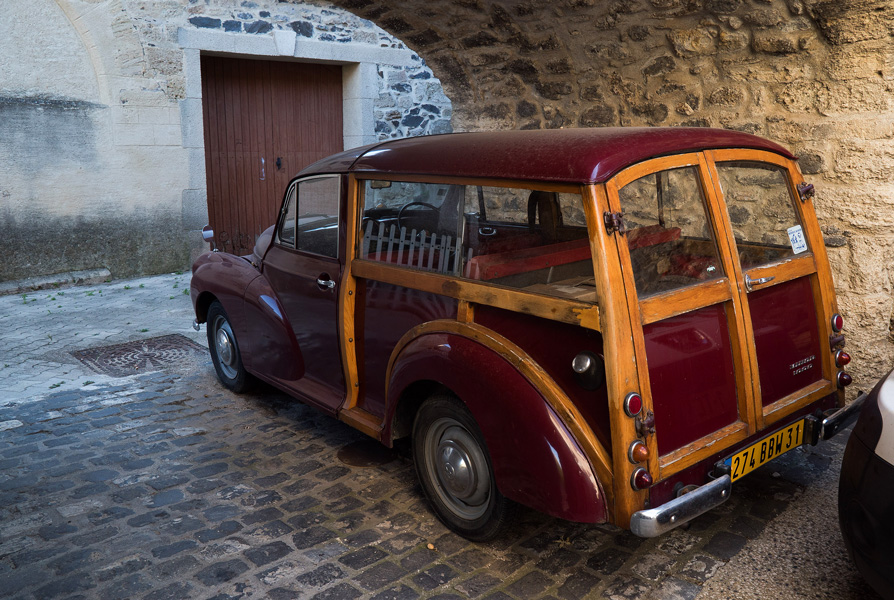 Vintage car in stone archway