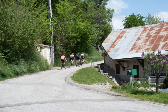 Group of cyclists on local road, French Alps