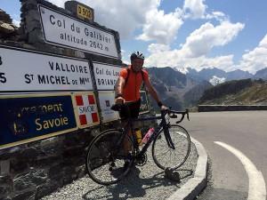 Cyclist at top of Col du Galibier