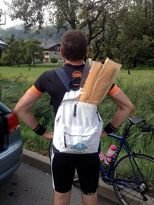 Cyclist with Baguette in Backpack