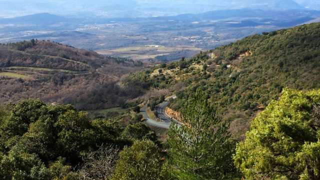 View over hills in the Cevennes with switchback in road
