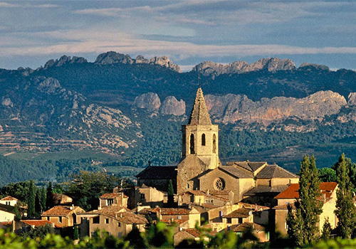 View of village of Mazan, Provence with Dentelles in background