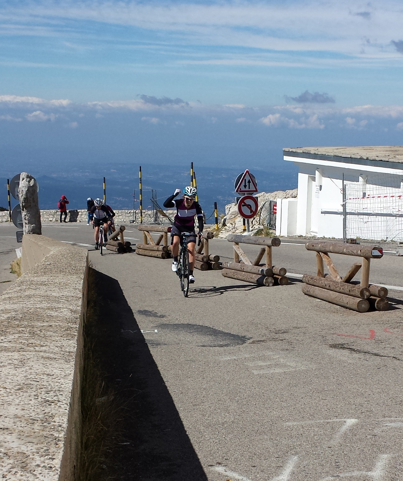 Female cyclists reaching the summit of Mont Ventoux
