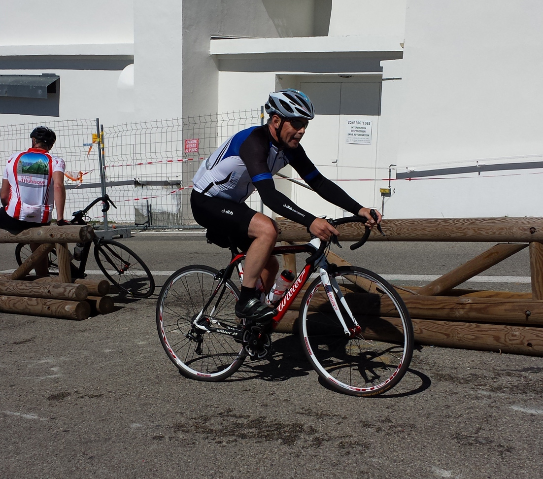 Cyclist reaching the summit of Mont Ventoux