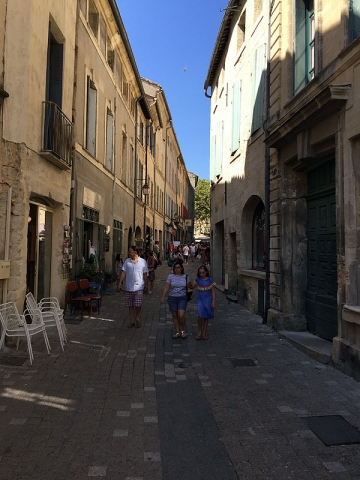 Cobbled shopping street in the historic centre of Uzès