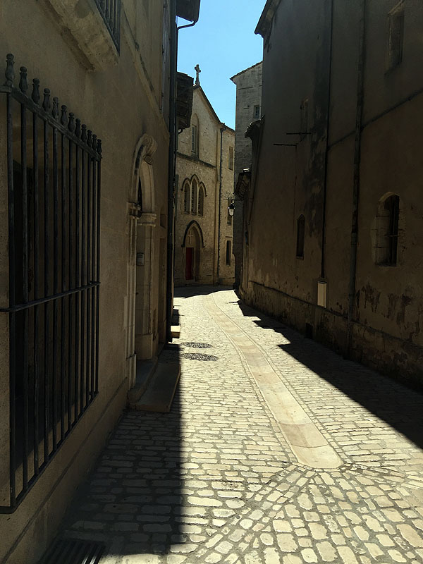 Narrow street in historic centre of Uzès, Languedoc