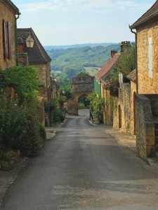 Cycling through the village of Domme, France