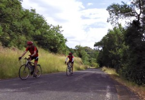 Cyclists climbing near Lac Salagou, Languedoc