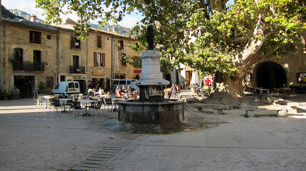 Relaxing in the Central Square, St. Guilhem le Desert, Languedoc