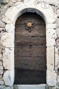 Cardabelle Flower on Doorway in St. Guilhem le Desert, Languedoc