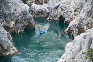 Kayakers on the Herault River at the Pont de Diable, Languedoc
