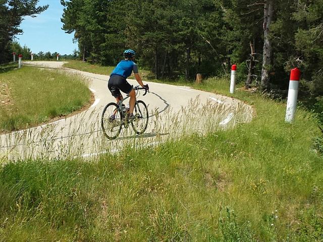 Female cyclist ascending Mt Ventoux via Sault