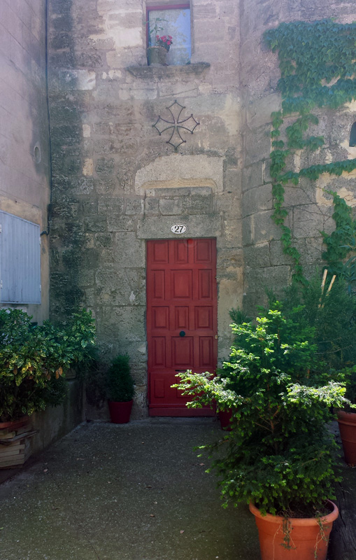Ancient Doorway with Languedocian Cross in Pezenas, Languedoc