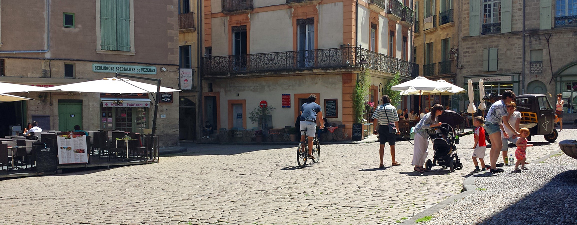 Cyclist in Central Square of Medieval Pezenas